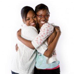 SistersHugging